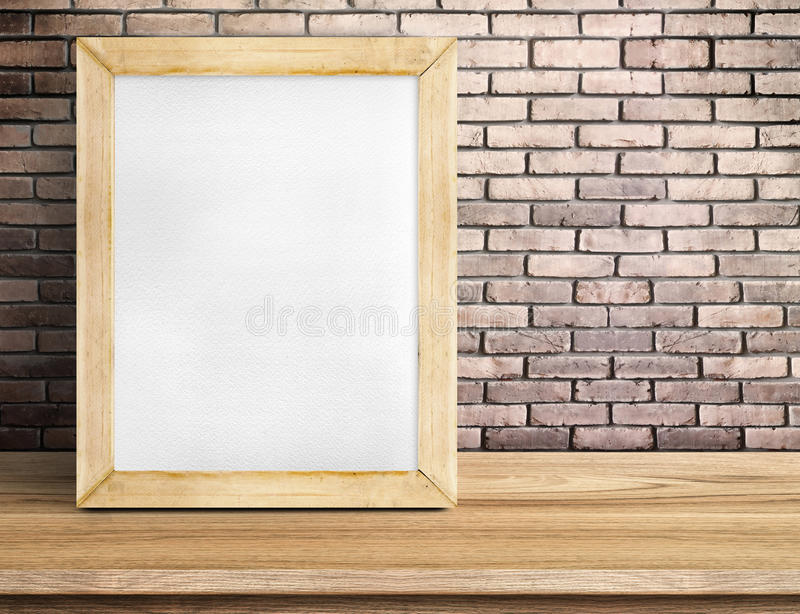 Blank paper white board on wooden table at red brick wall,Template mock up for adding your design and leave space beside frame royalty free stock photography