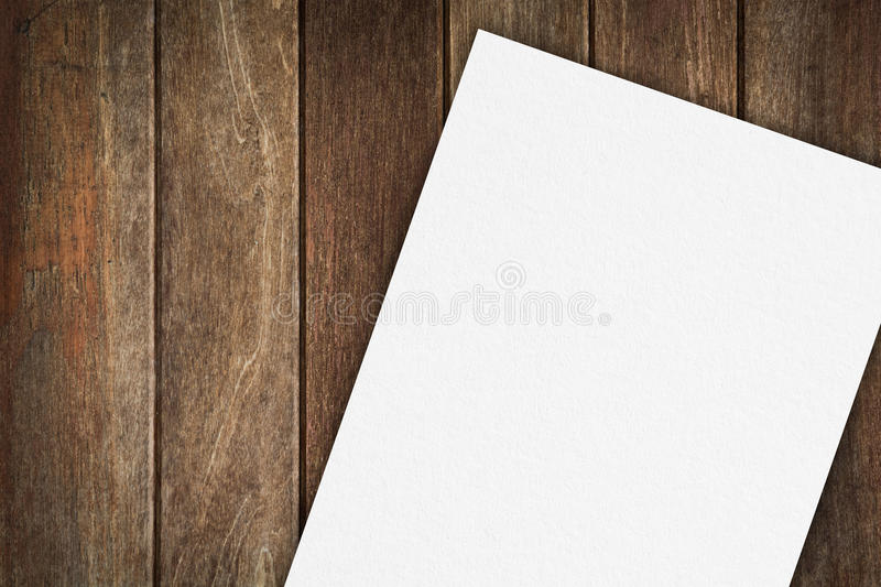 Blank paper on wood table stock photo