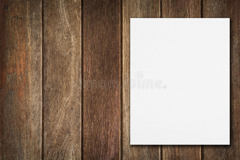 Blank paper on wood table stock image