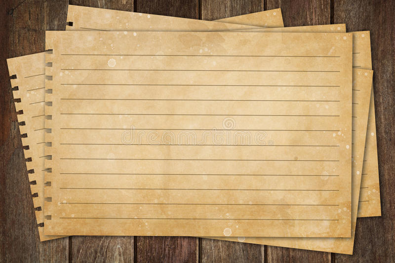 Blank paper on wood table royalty free stock photography
