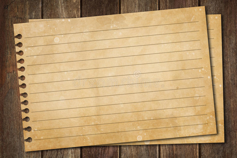 Blank paper on wood table royalty free stock photo