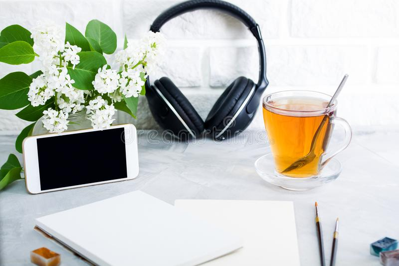 Blank phone mockup tools for painting tea headphones royalty free stock photography
