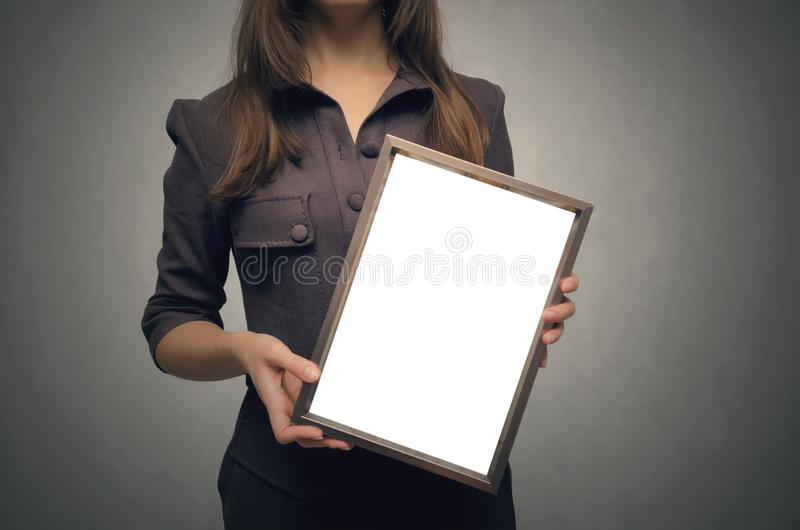 Blank photo frame border in woman hands. Diploma. Certificate. stock photography