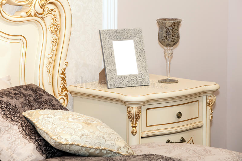 Blank photo frame on the chest of drawers royalty free stock photos