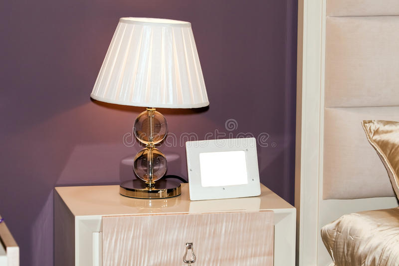 Blank photo frame on the chest of drawers royalty free stock photography