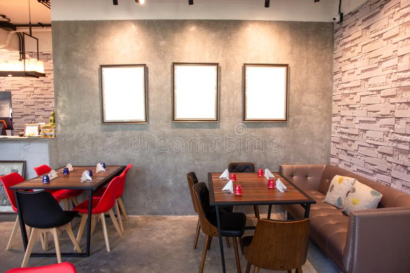 Blank photo frame on grey wall in restaurant royalty free stock photos