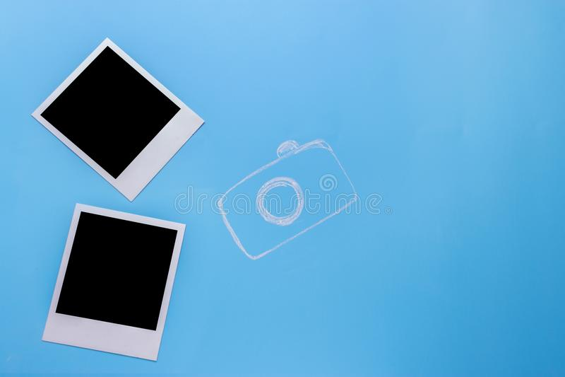 Blank photo frames, camera. On blue background stock images