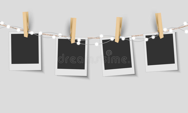 Blank photo frames with fairy lights stock illustration