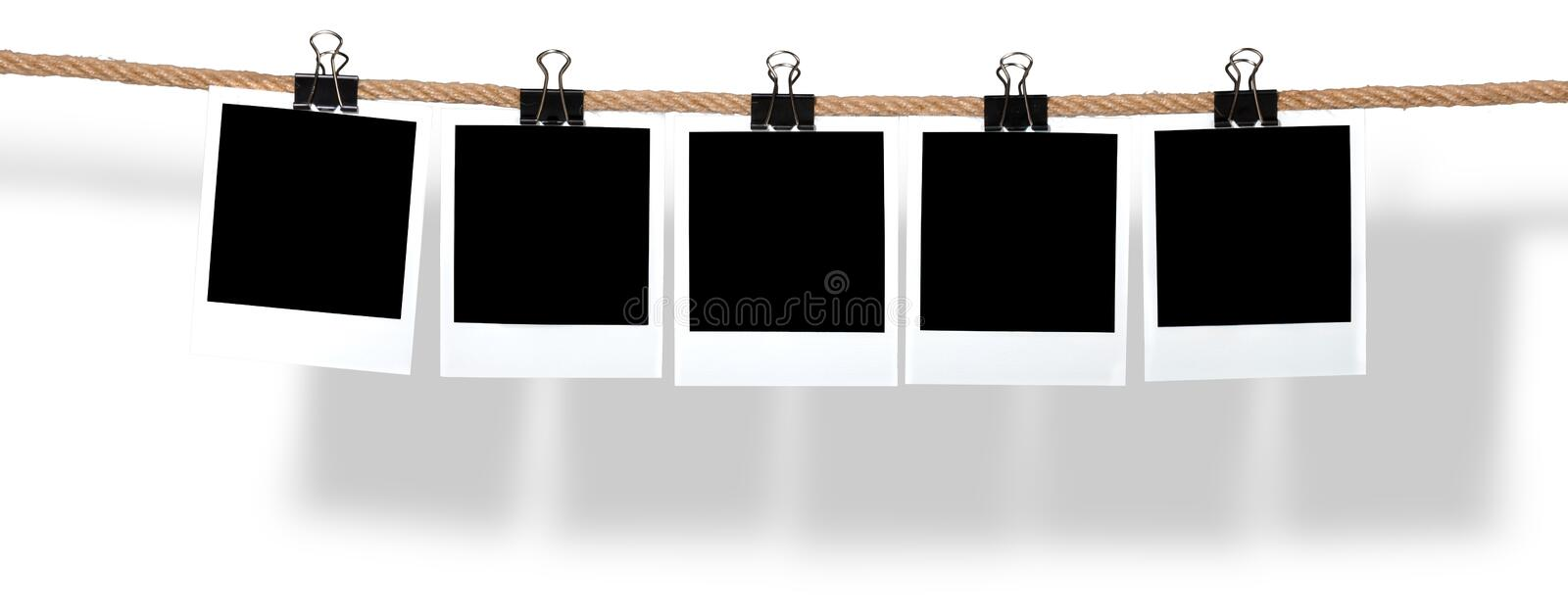 Blank Polaroids Hanging from a Rope stock image