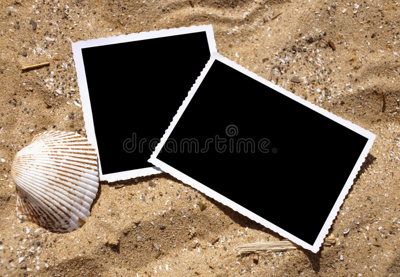 Blank Photograph Memory Pictures on Sand royalty free stock photography