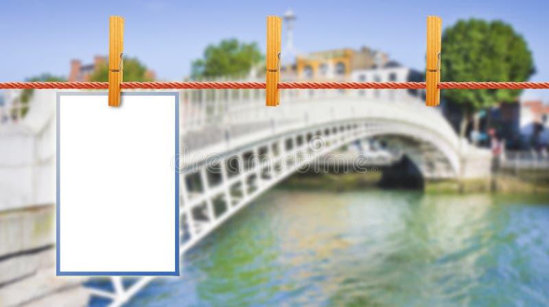 Blank photos hanging on clothesline with Half Penny Bridge on ba royalty free stock photos
