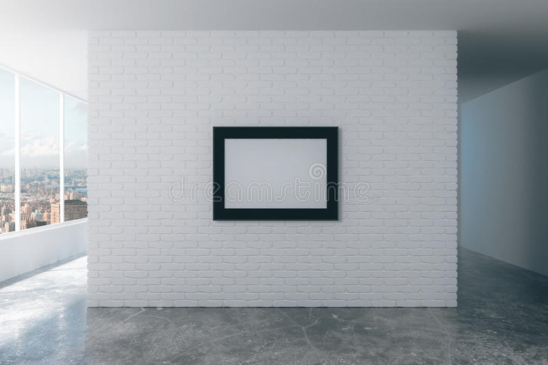 Blank picture frame on white brick wall in empty loft room, mock royalty free stock image