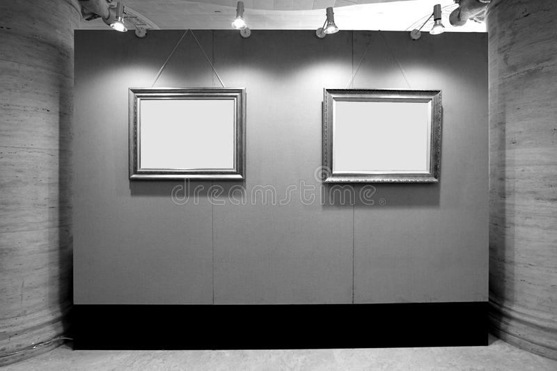 Blank picture frames in art gallery royalty free stock images