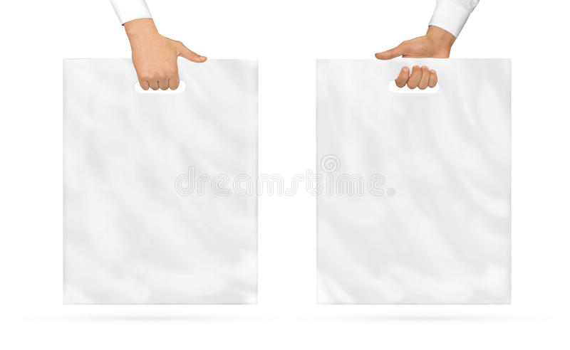 Blank plastic bag mock up holding in hand. Empty polyethylene. Package mockup hold in hands isolated on white. Pack ready for logo design or mall identity royalty free stock image