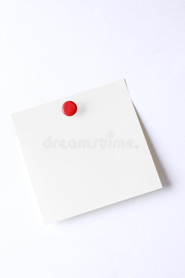 Blank post-it sticky note with push pin isolated on white background royalty free stock photos