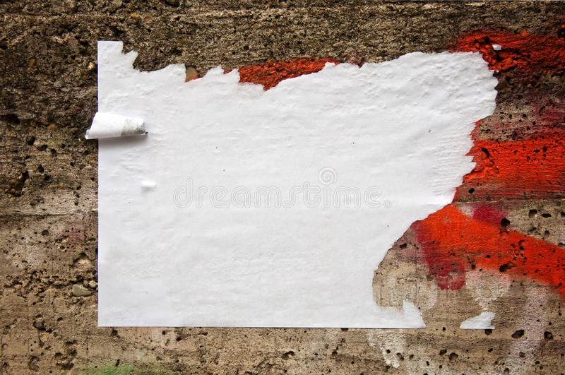 Blank poster. Blank torn paper poster on an old brick wall royalty free stock image