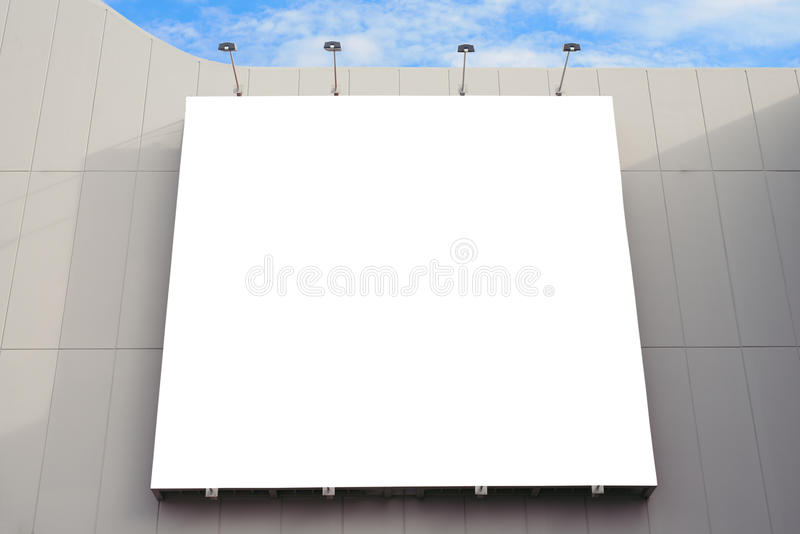 Blank poster board wall with copy space for your text message in modern shopping mall on a cloudy day. stock photos