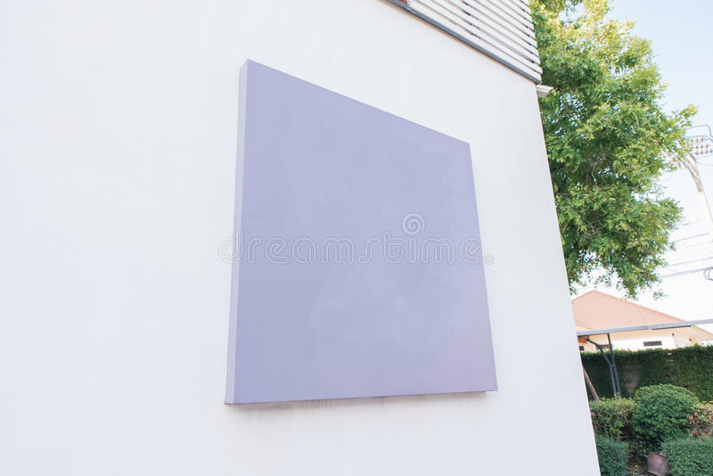 Blank poster board wall in modern shopping mall on cloudy day. Blank poster board wall in modern shopping mall on a cloudy day stock images