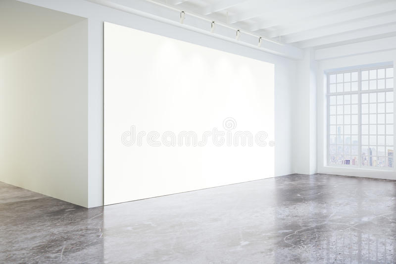Blank poster in light modern loft gallery with big windows and c. Oncrete floor, mock up stock photography