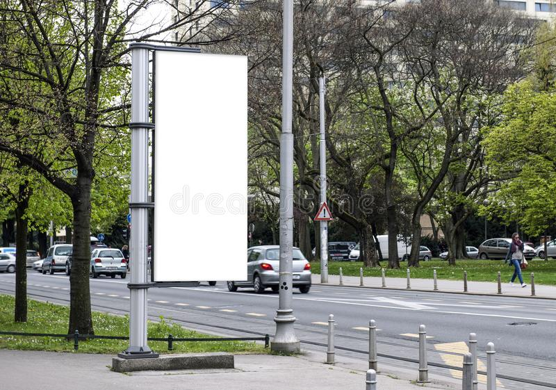 Blank Poster, city street in Zagreb. Blank Poster mock up in Zagreb. Trees in the background royalty free stock image