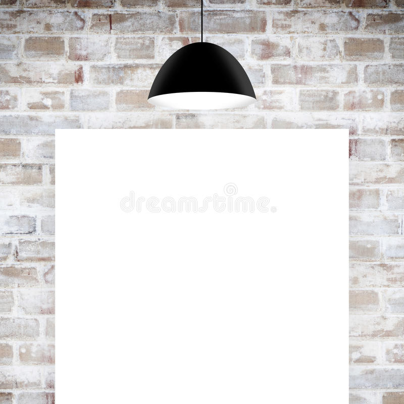 Blank poster over wall. Blank poster over brick wall royalty free stock photo