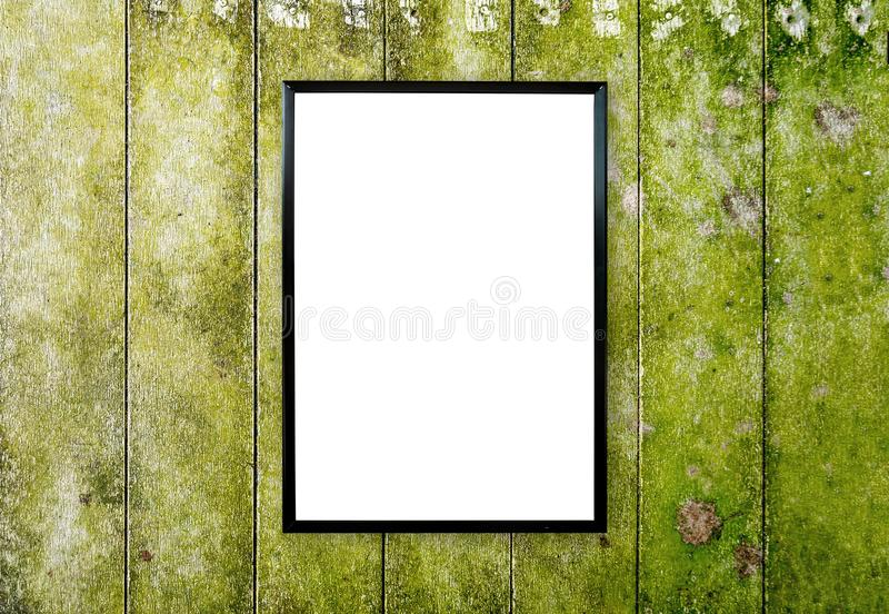 Blank poster photo frame on wood wall. Blank poster photo frame on abstract wood wall royalty free stock images