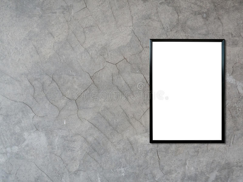 Blank poster photo frame on cement wall. Blank poster photo frame on vintage cement wall background royalty free stock photo