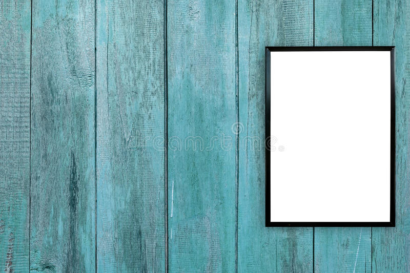 Blank poster photo frame on wood wall stock image