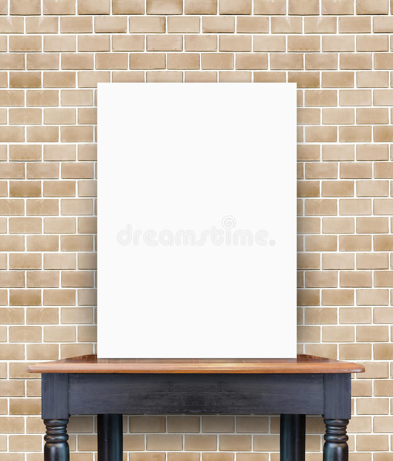 Blank poster on vintage wooden table at brick tiles wall,Template for add your content.  royalty free stock images