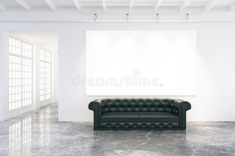 Blank poster on the wall in loft room with black leather sofa an stock photography