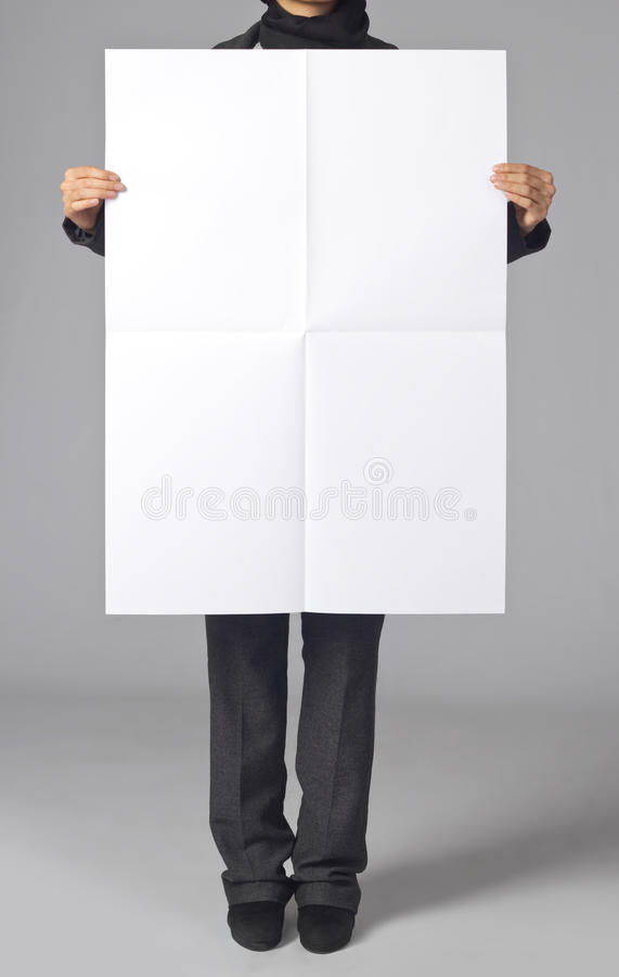 Blank poster. Woman holding a blank poster royalty free stock image