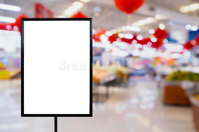 Blank price board with Supermarket store. Abstract blur background with bokeh stock photography