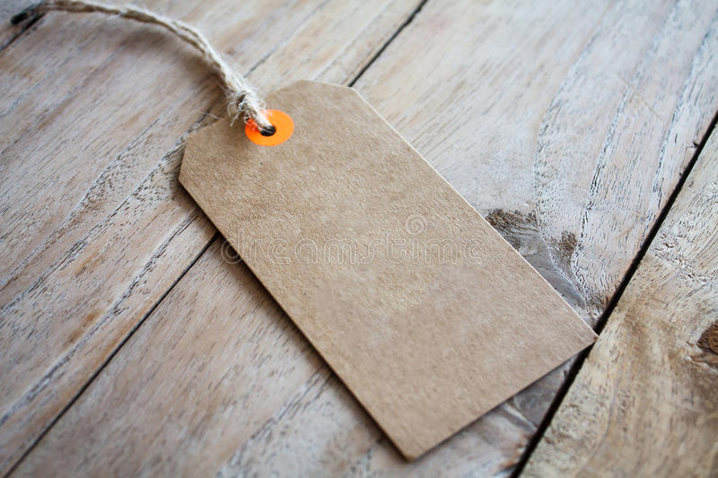 Blank price tag on wood background stock image