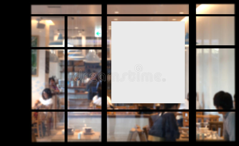 Blank promotion poster on glass window royalty free stock image