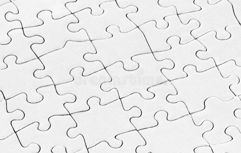 Blank puzzle. A blank white puzzle texture royalty free stock photography