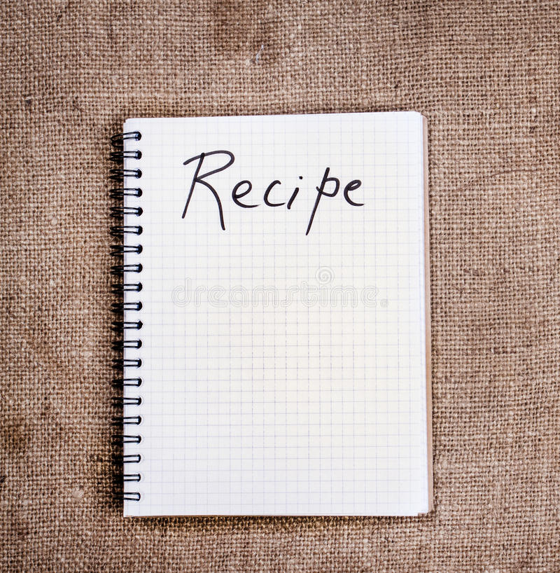 Blank recipe book on sack cloth stock photography