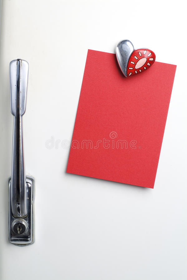 Blank red note on fifties fridge-door, heart shaped-magnet, copy stock photography