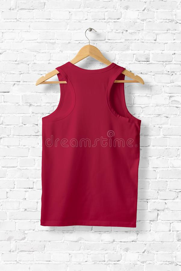 Blank Red Tank Top Mock-up hanging on white wall. royalty free illustration
