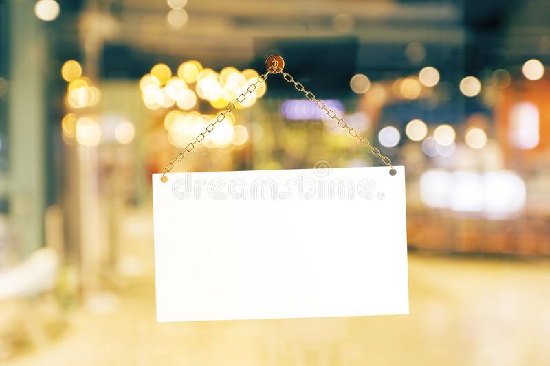 Blank retail sign. Blank white retail store sign on blurry background. Advertising concept. Mock up, 3D Rendering stock photography