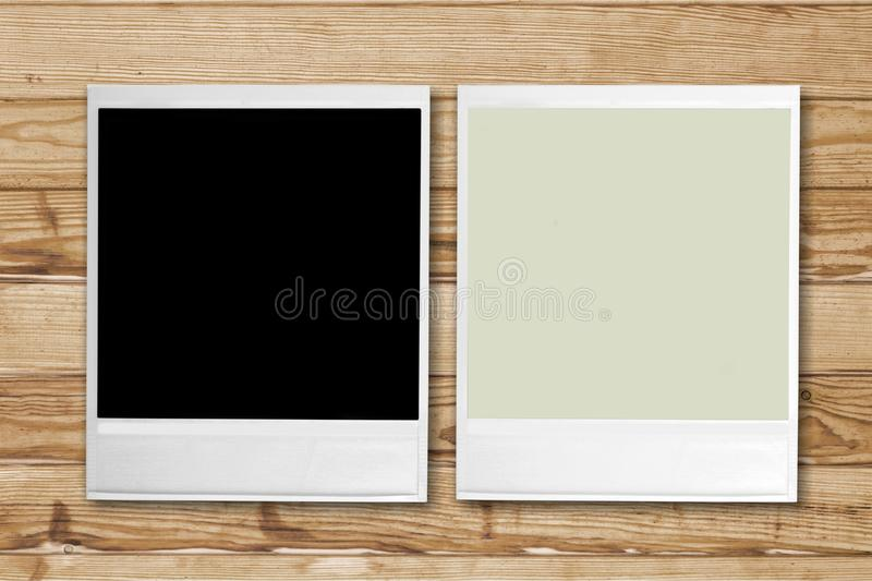 Blank retro photo frames on wooden background royalty free stock photo
