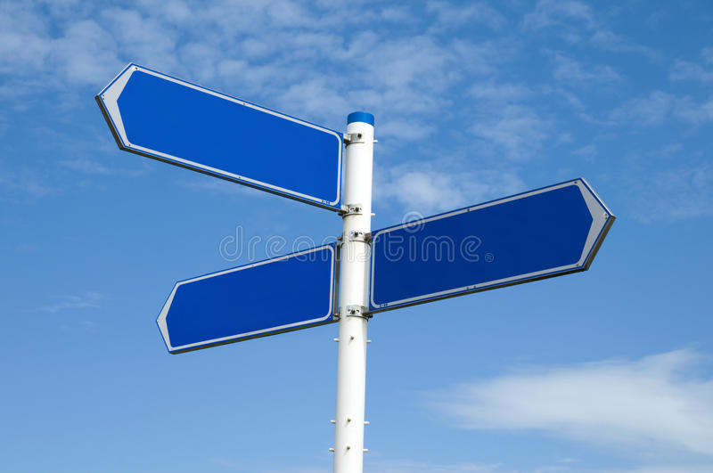 Blank road sign. Against a blue cloudy sky royalty free stock image