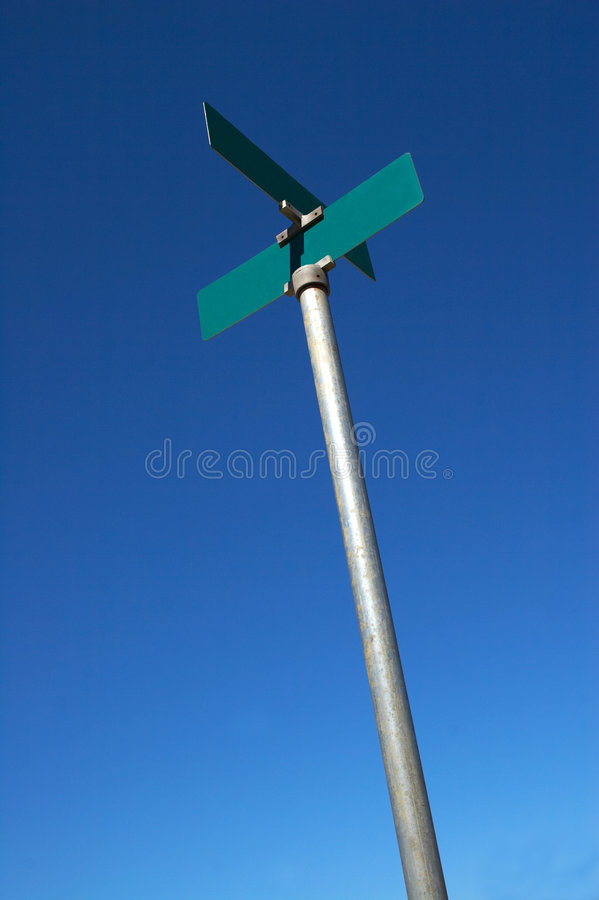 Blank road sign on blue sky stock photo