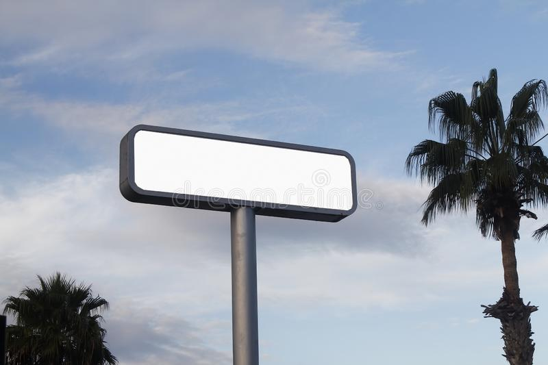 Blank road sign on blue sky stock photos