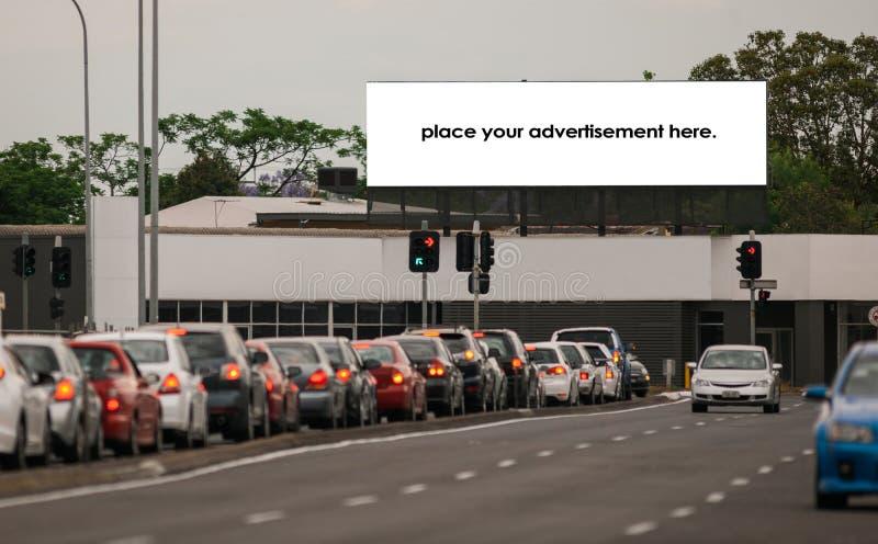 Blank roadside advertising billboard at daytime stock photo