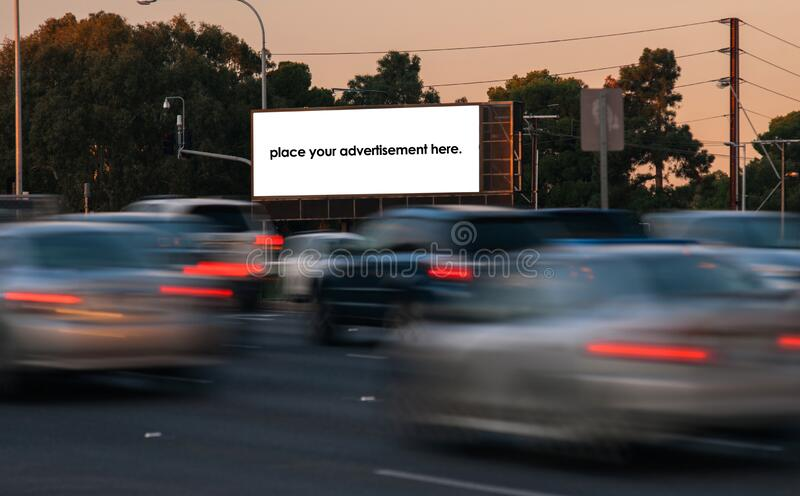 Blank roadside advertising billboard at twighlight stock photography