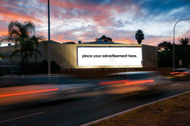 Blank roadside advertising billboard at twighlight royalty free stock photos