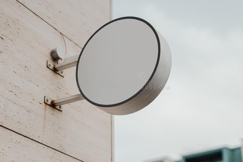 Blank round store signboard. Empty shop lightbox on the wall. 7 stock photo