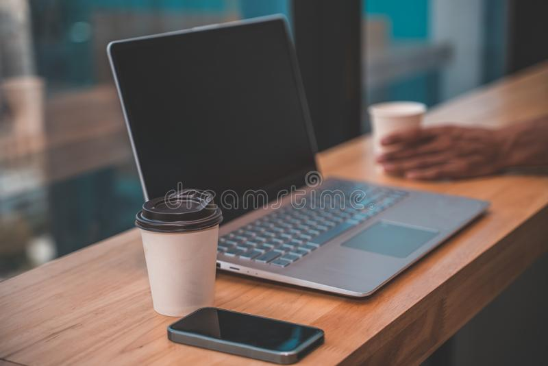 Blank screen laptop on modern office desk at workplace. Workplace concept stock images