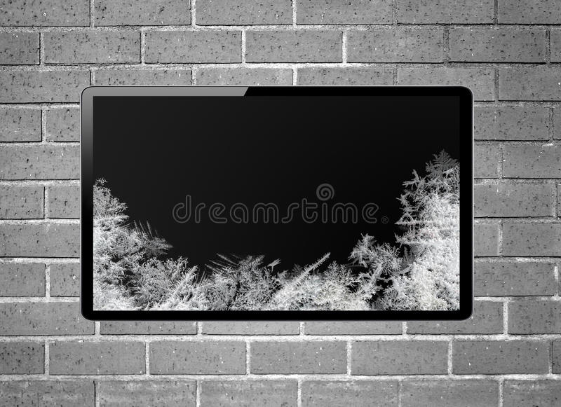 Blank screen LCD tv with frost screen hanging on wall. Blank screen LCD tv with frost screen hanging on a wall royalty free stock photo