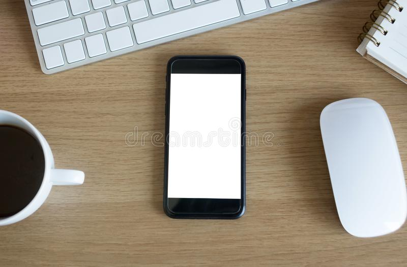 Blank screen smartphone on office table stock photos